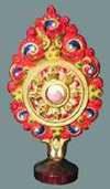 Дхармачакра - символ Учения Будды. Алтарное украшение. Монголия, XIX в.